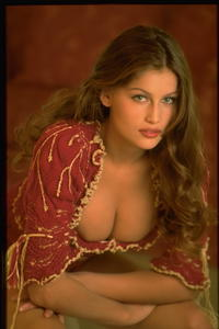 Laetitia Casta sexy uncovered boobs and legs