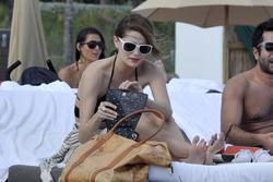 http://img220.imagevenue.com/loc847/th_531265576_Mischa_Barton_Bikini_Candids_on_the_Beach_in_Miami_December_27_2011_225_122_847lo.jpg